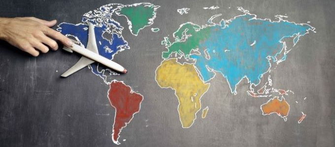 world map in chalk with toy airplane